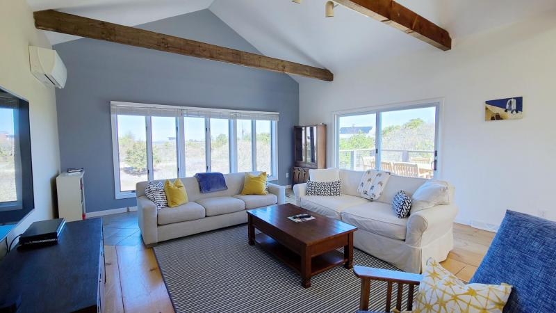 Living room has water views of the bay
