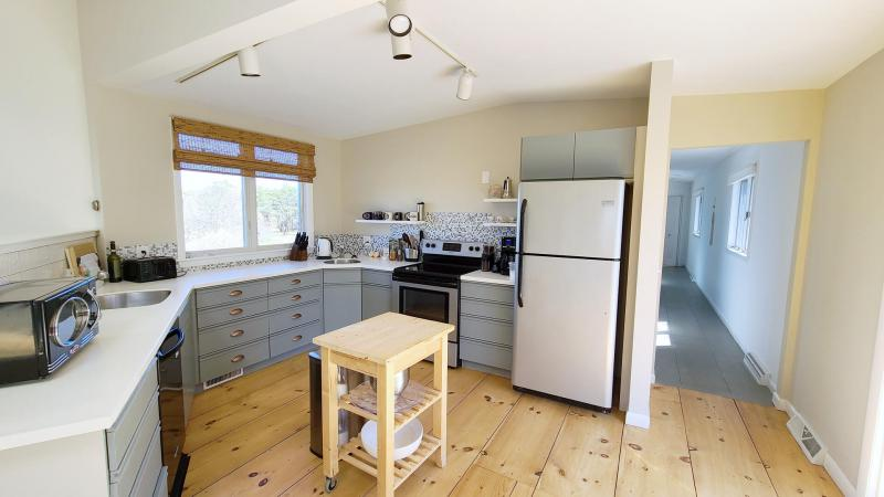 Open and bright kitchen is nicely equipped