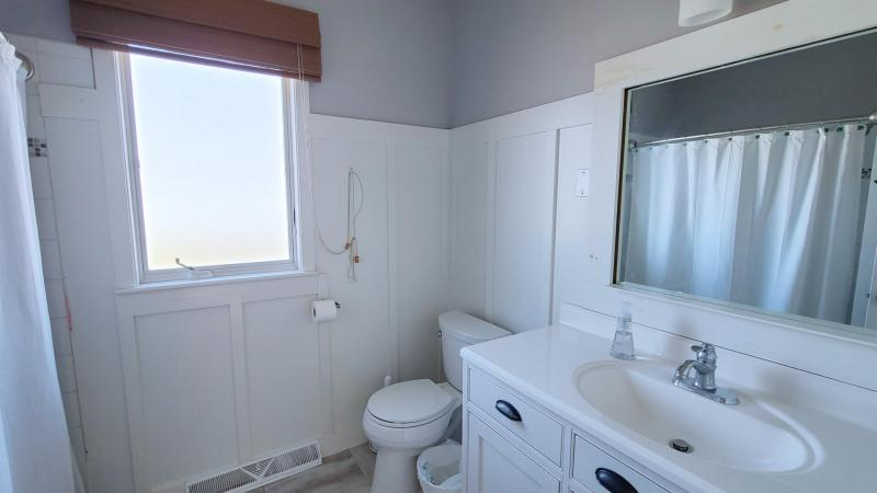 Main level bathroom with tub and shower
