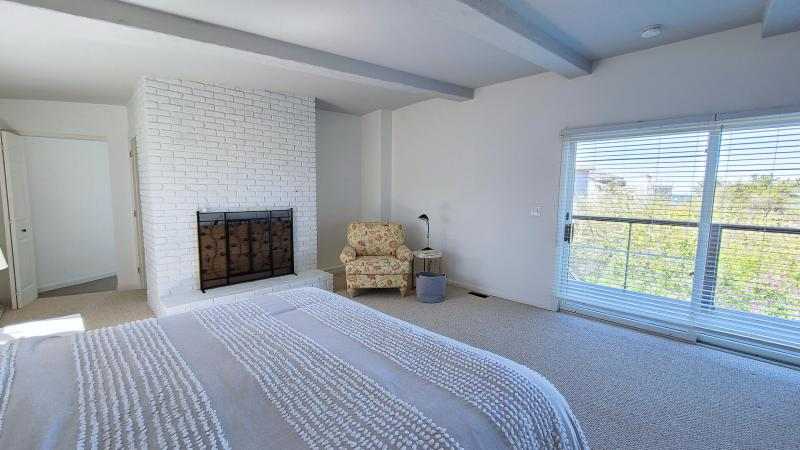 Main level master with king bed and balcony