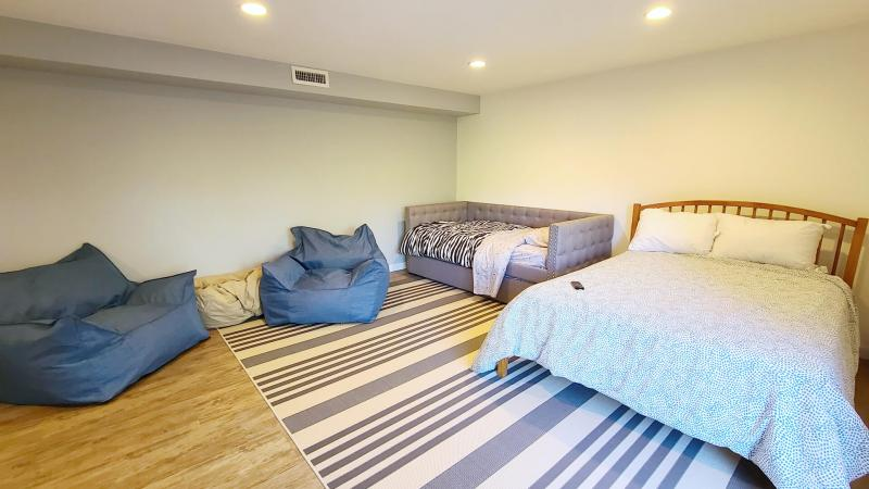 Ground floor bedroom with comfortable seating and TV