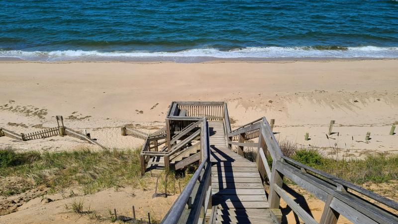 Stairs lead to beautiful association beach
