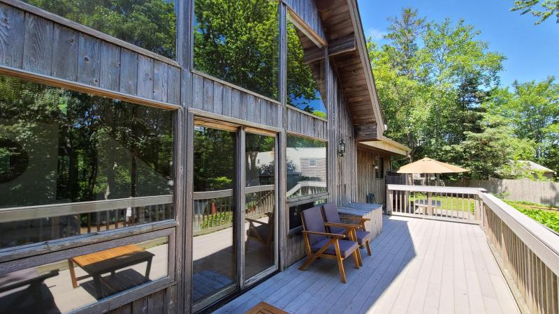 Front deck with patio and outdoor shower beyond