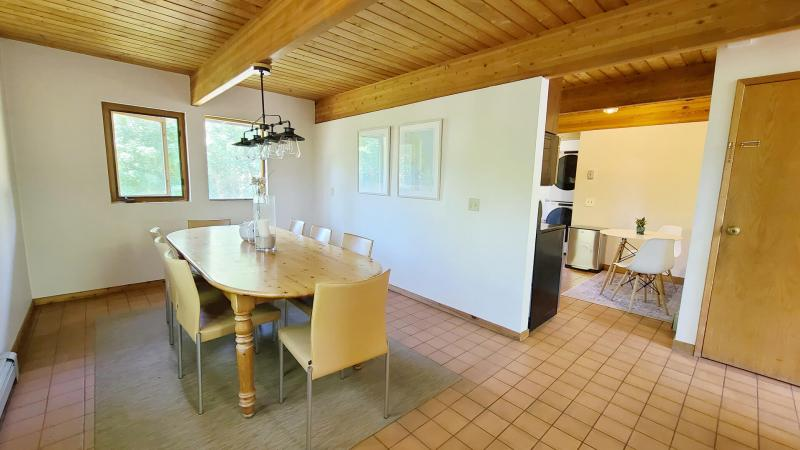 Separate dining room with kitchen beyond