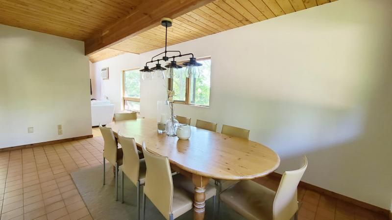 Dining room has a large table with plenty of seating