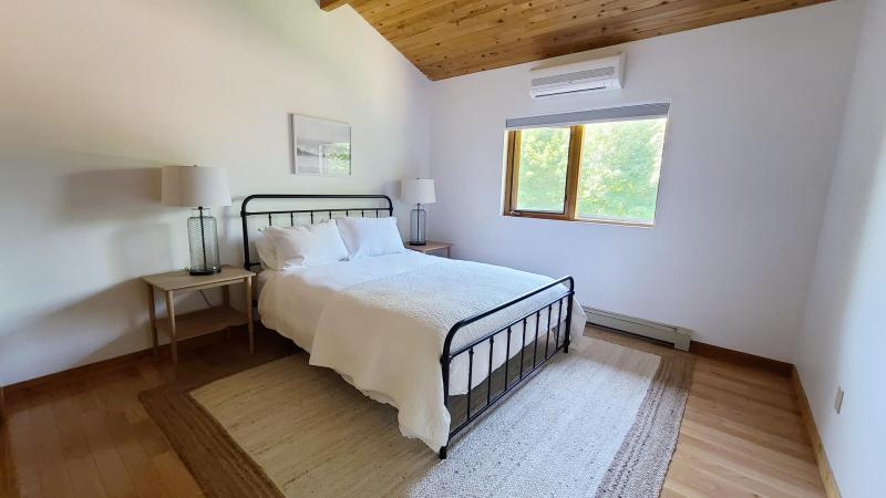 First floor bedroom with queen bed and vaulted ceiling