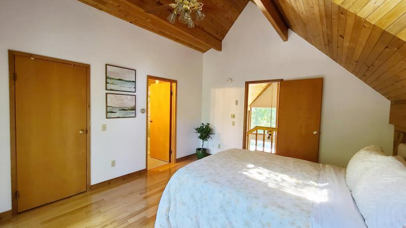 Second floor master with queen bed and ceiling fan