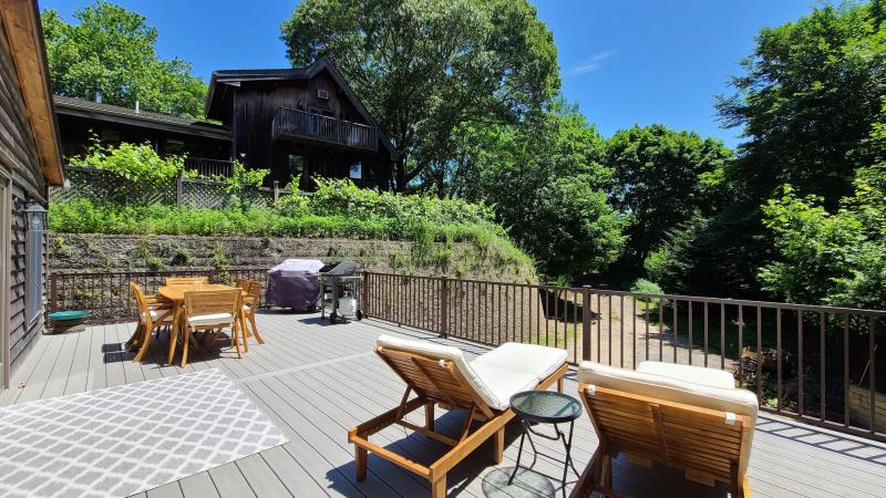 Beautiful deck with outdoor furniture and gas grill