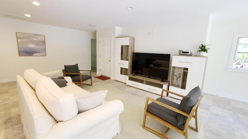 Living room with comfortable seating and flat screen TV