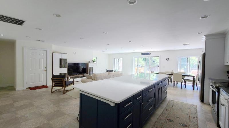 Kitchen looks out over living room and dining area