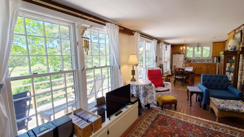 Slider leads to deck with Duck Creek views