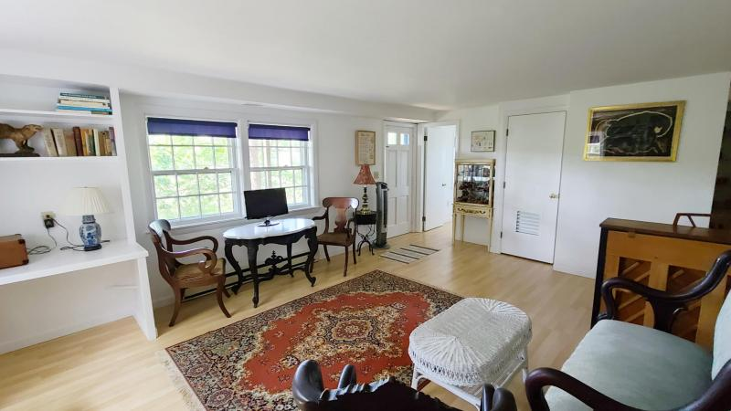 Lower level family room with TV and piano