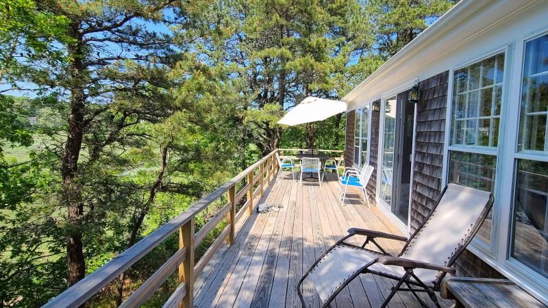 Enjoy the wonderful deck with furniture and Duck Creek views
