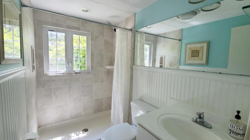 First floor bathroom with tiled shower