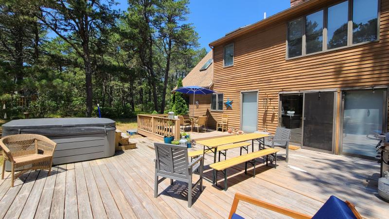 Large deck with Jacuzzi and outdoor seating