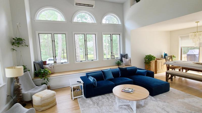 Living room with open sleeping loft above