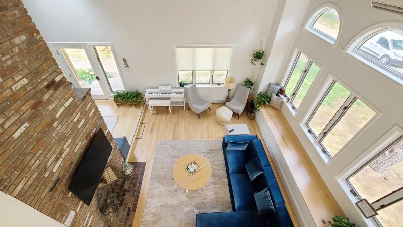 View of living room from open sleeping loft above