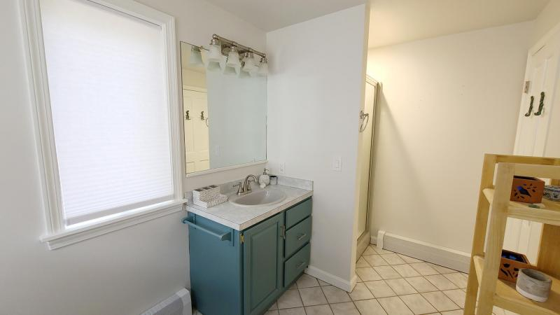 First floor bathroom with shower and washer and dryer