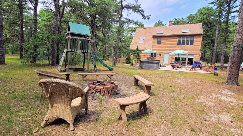 Enjoy the fire pit in the backyard