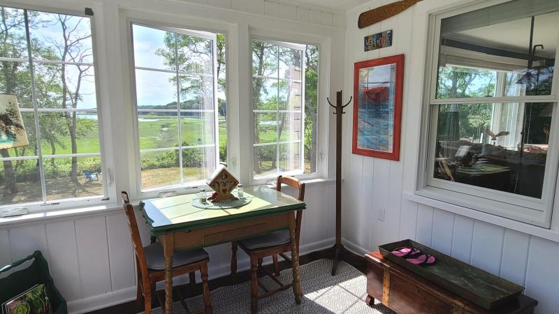Lovely screen porch with Blackfish Creek views