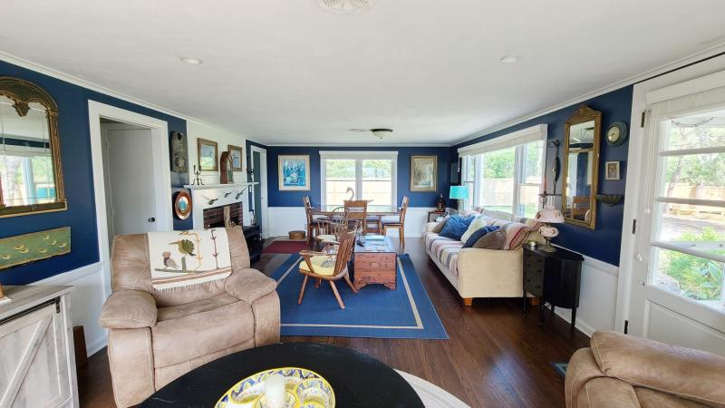 Main living area with comfortable seating and large dining table