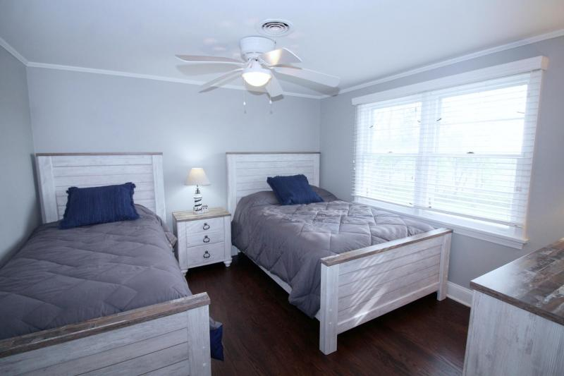First floor bedroom with one twin bed and one double bed