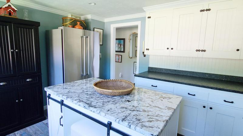 Well equipped kitchen has stainless appliances