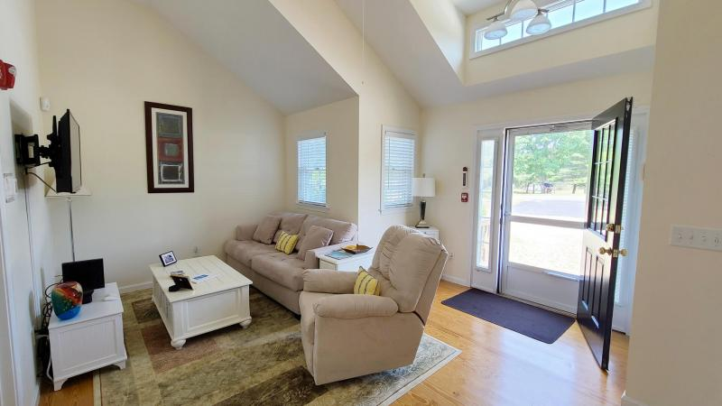 Bright and open main living area with soaring ceiling