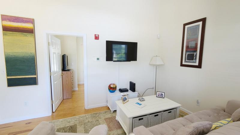 Living room has comfortable seating and flat screen TV