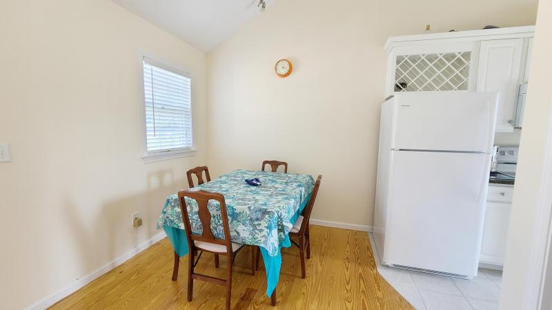 Dining area with table just off kitchen