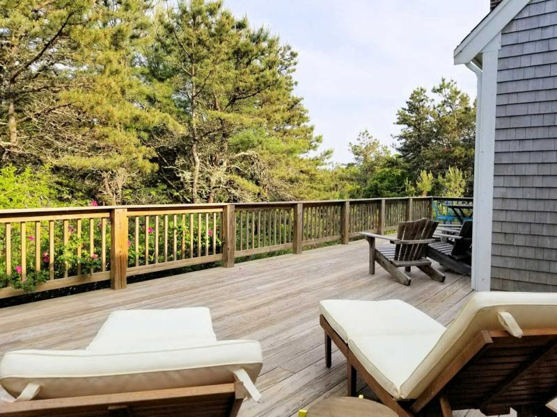 Large deck has wooded view