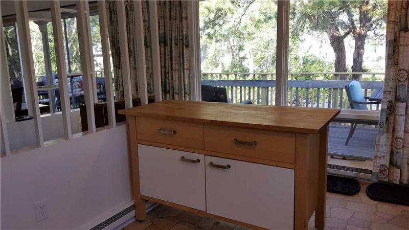 Kitchen looks out over deck
