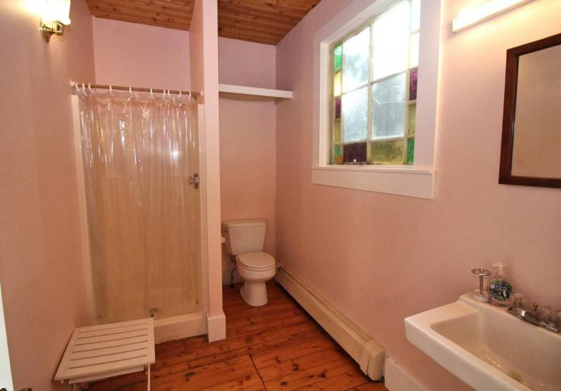 First floor bathroom with shower in carriage house