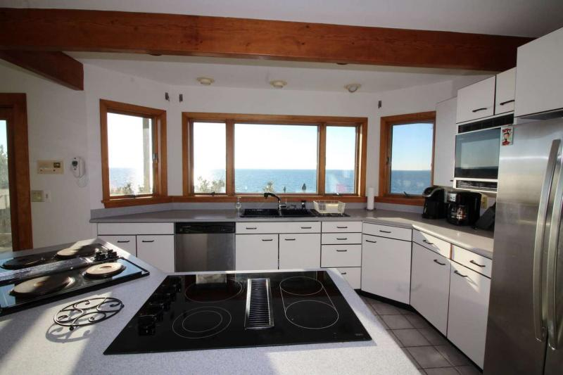 Large bright kitchen with water views