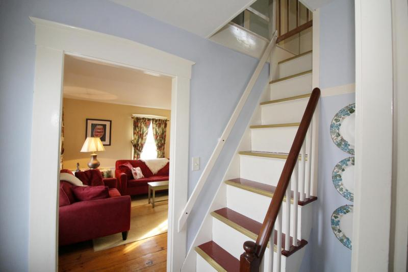 Front staircase leading to second floor