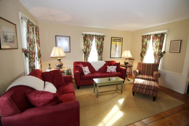 Family room with comfortable furniture and flat screen TV