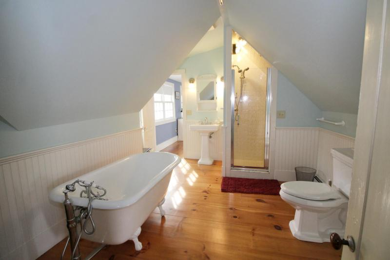 Second floor bathroom with shower and clawfoot tub