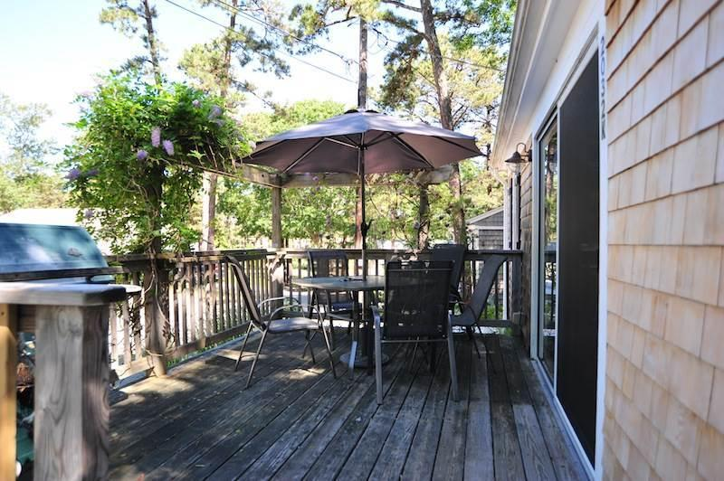 Front deck with outdoor furniture and gas grill