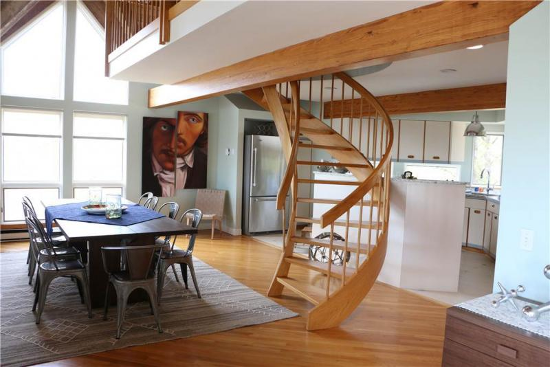 Dining room with stairs to loft