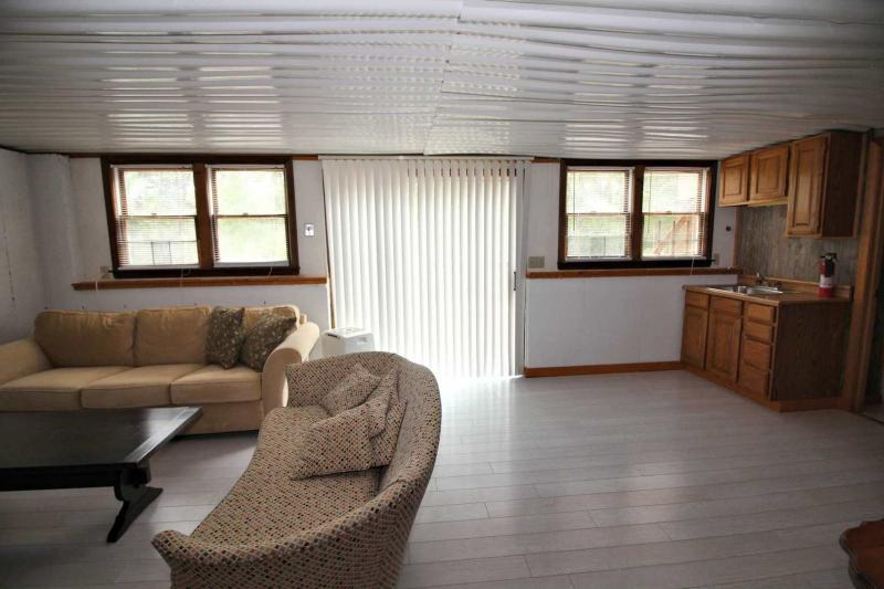 Lower level sitting area with slider to deck