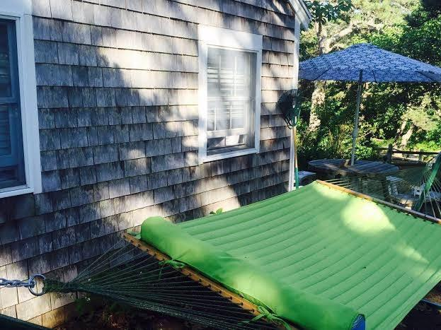 Hammock on the side of the cottage