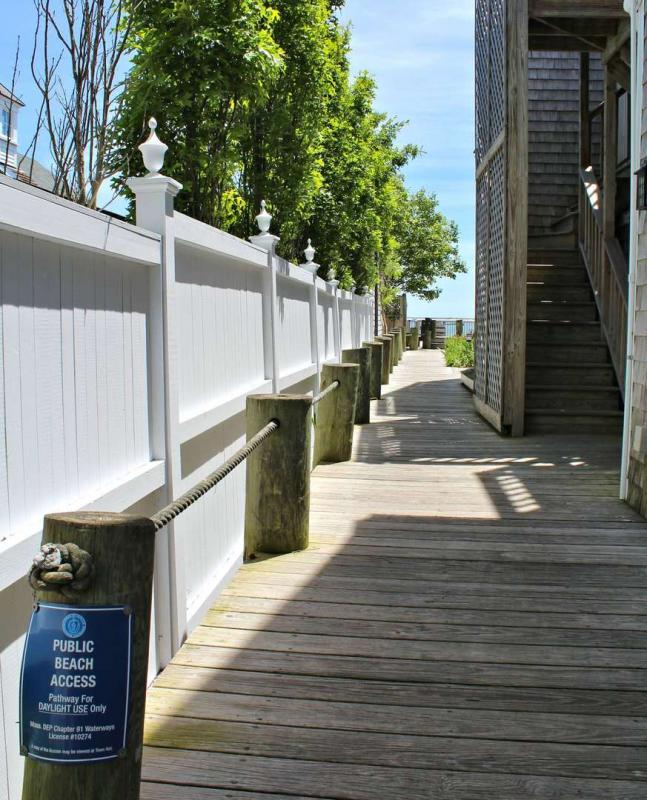 Follow walkway to common deck and beach stairs