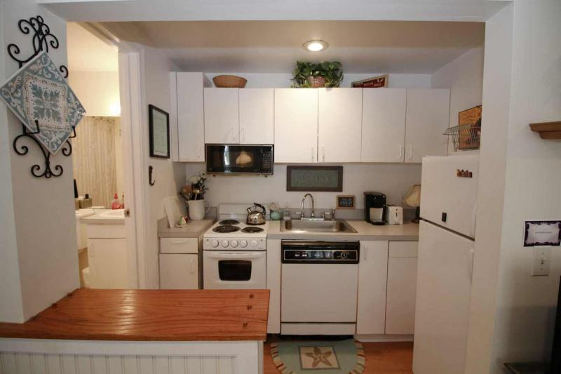 Nicely equipped kitchen off living area