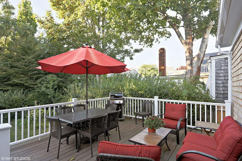 Lounge on the beautiful deck in the private yard