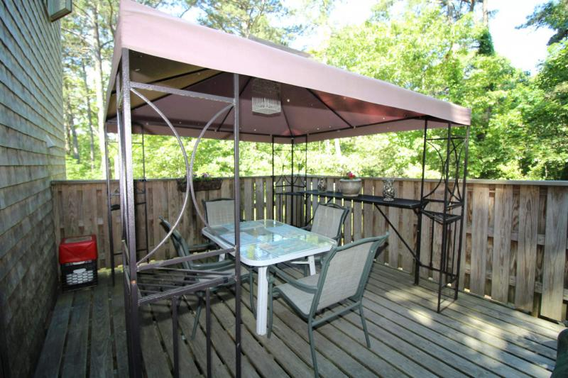 Private deck with table and chairs and gas grill