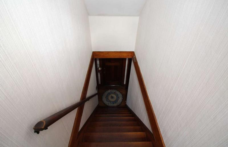 Stairs down to first floor