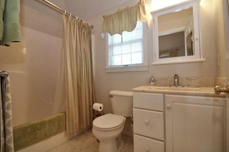 Studio apartment has a full bathroom with tub and shower