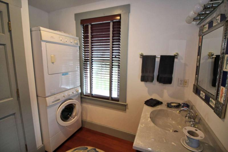 First floor bathroom with shower and laundry