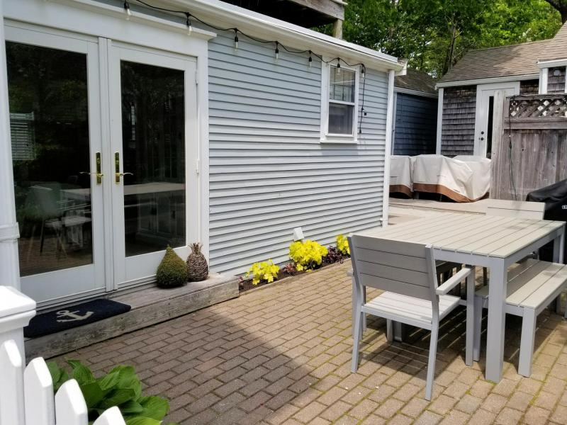 Nice patio with table and chairs and grill