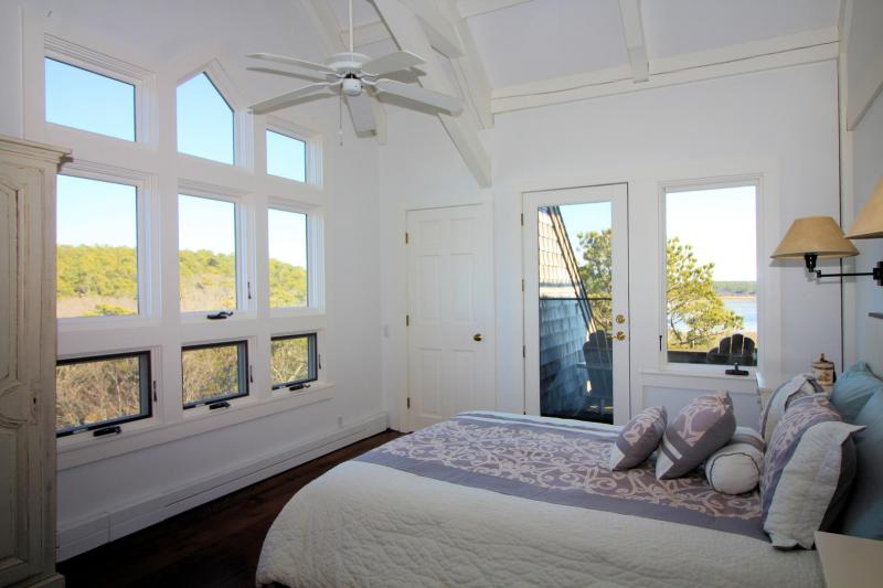 Master with queen bed and private balcony deck